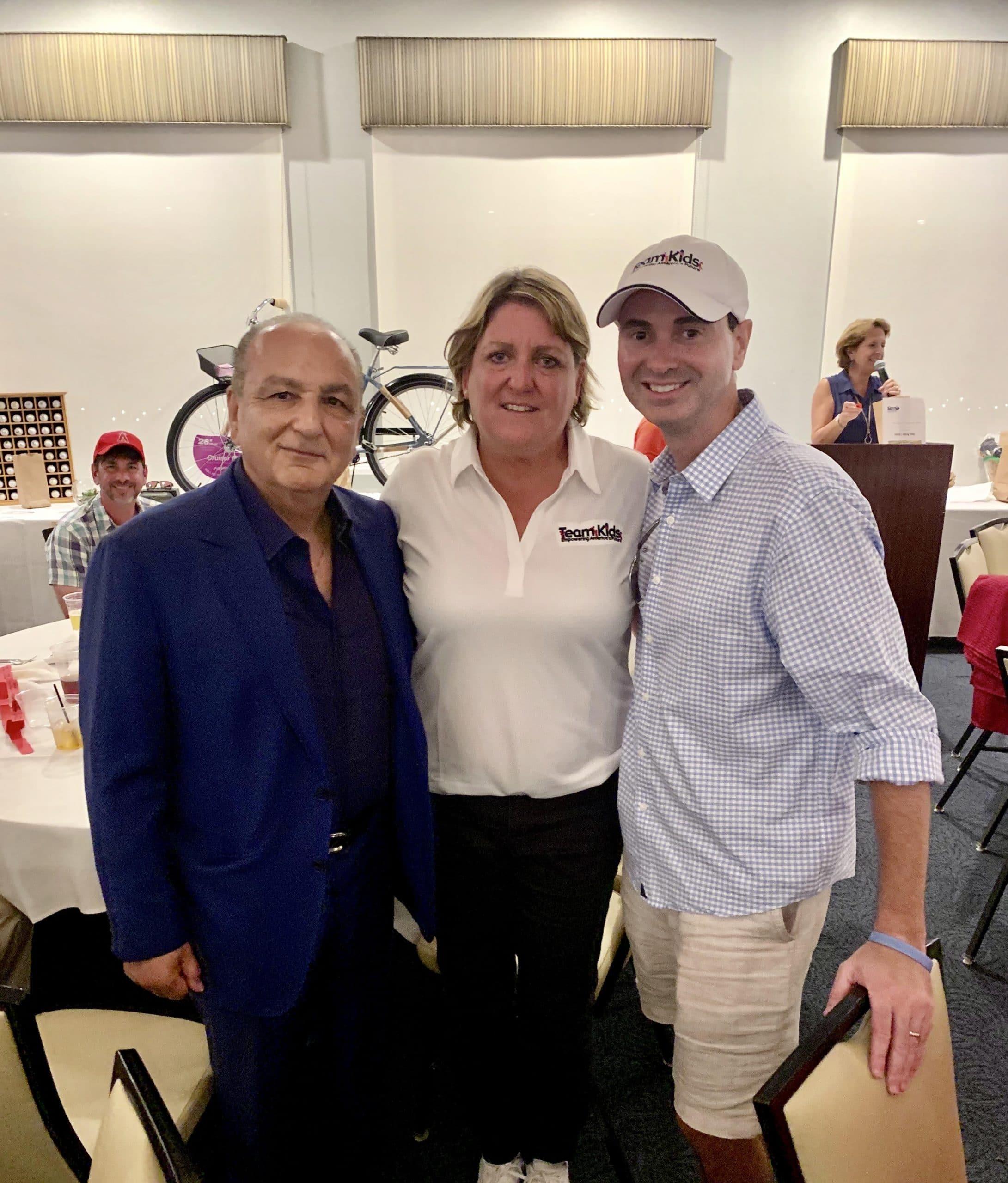 Cameron Merage, Julie Hudash, and Charles Glorioso at the Superhero Golf Classic