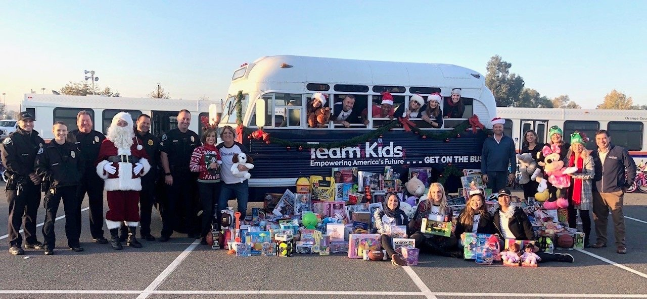 Team Kids bus stuffed with toys for the Spark of Love Toy Drive