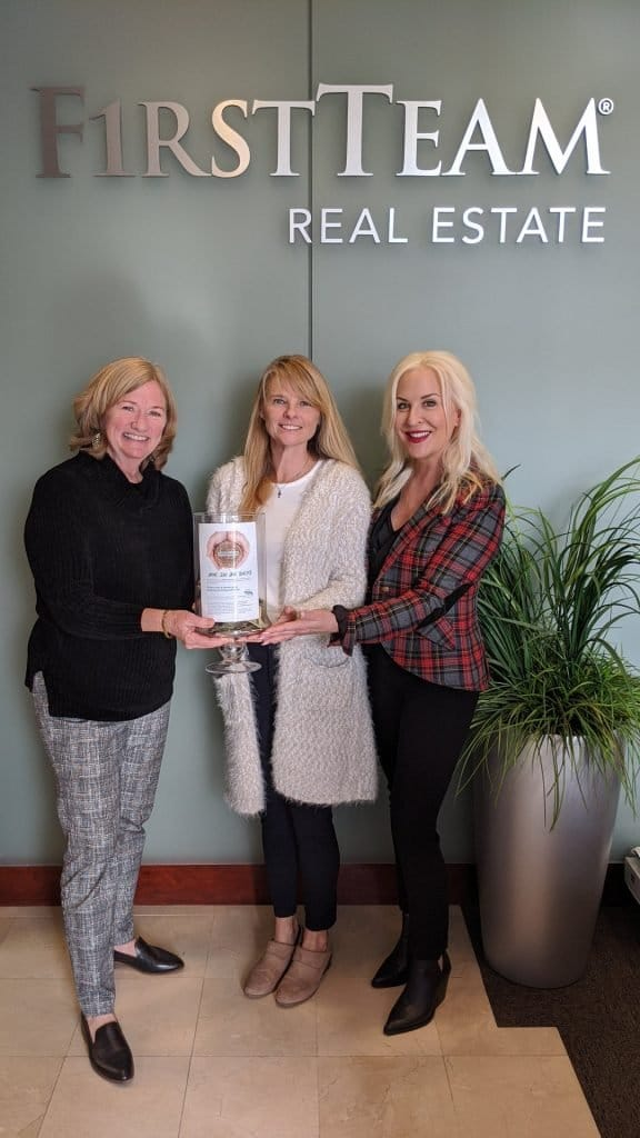 First Team Real Estate Huntington Beach - Seacliff manager and agent presenting Robyne's Nest with fundraiser contribution