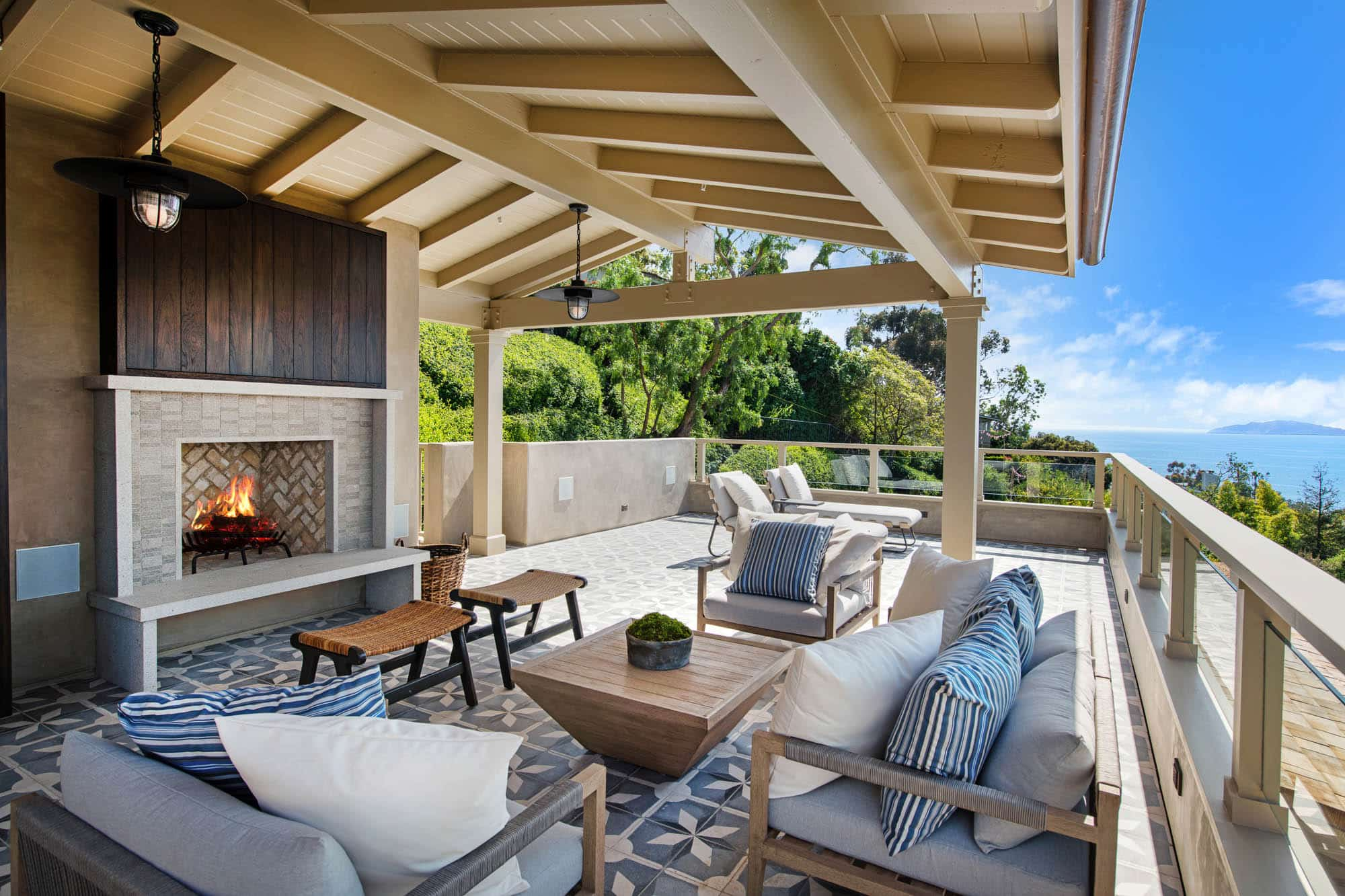 Luxury Outdoor Living Space With Ocean Views And Outdoor Fireplace